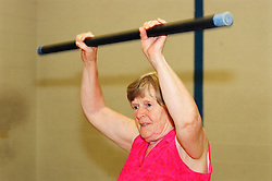 Elderly woman taking part in a keep fit class; Huddersfield; UK