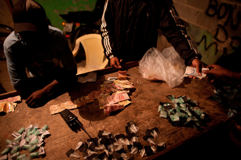 In this Aug.  8, 2012 photo, traffickers sell drugs in the Antares slum in Rio de Janeiro, Brazil. <br /> <br />  The South American country began experiencing a public health emergency in recent years as demand for crack boomed and open-air &quot;cracolandias,&quot; or crack lands, popped up in the sprawling urban centers of Rio and Sao Paulo, with hundreds of users gathering to smoke the drug. The federal government announced in early 2012 that more than $2 billion would be spent to fight the epidemic, with the money spent to train local health care workers, purchase thousands of hospital and shelter beds for emergency treatment, and create transitional centers for recovering users.