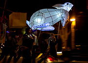 Lemmy Epstein, Frank Hannan and Andrea Piller carry the Hare lantern during the third annual Firelight Lantern Festival in Picton, Ont on Nov. 14, 2015. The lantern, which is made of bamboo and bed sheets, was designed by event organizer Krista Dalby.