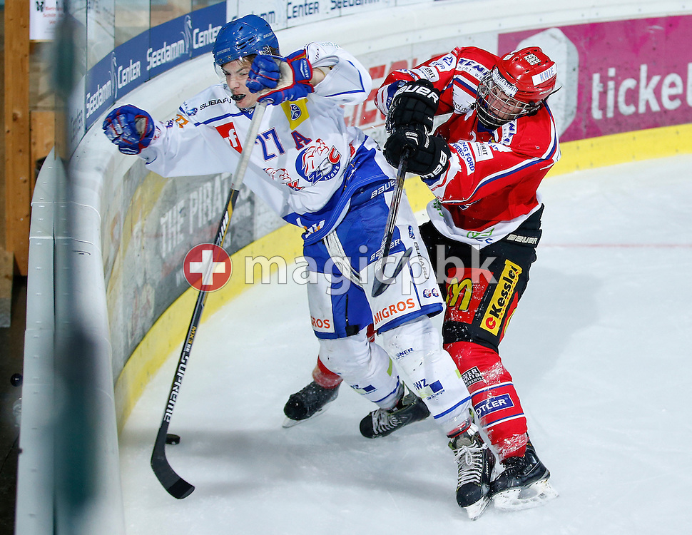Rapperswil-Jona Lakers defenseman Antoine Janssen (R) and ZSC Lions forward Simeon Kutil fight for the puck during an Elite B Regular Season ice hockey game between Rapperswil-Jona Lakers and ZSC Lions held at the SGKB Arena in Rapperswil, Switzerland, Friday, Oct. 28, 2016. (Photo by Patrick B. Kraemer / MAGICPBK)