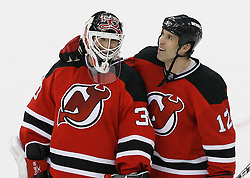 Mar 12, 2009; Newark, NJ, USA; New Jersey Devils center Brian Rolston (12) and New Jersey Devils goalie Martin Brodeur (30) share a laugh after their game at the Prudential Center. The Devils defeated the Coyotes 5-2, and New Jersey Devils goalie Martin Brodeur (30) moved to within one win of tying Patrick Roy for the all-time win record.