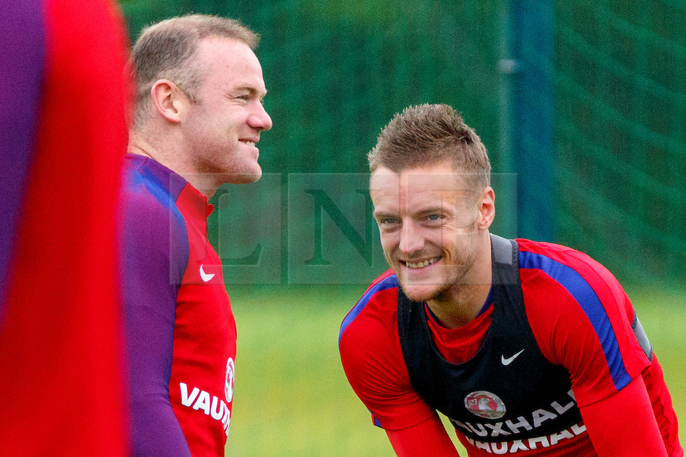 © Licensed to London News Pictures. 01/06/2016. London, UK. England's WAYNE ROONEY and JAMES VARDY speaking whilst England team train at Watford Training Ground on Wednesday, 1 June 2016, ahead of the Euro 2016 in France. Photo credit: Tolga Akmen/LNP