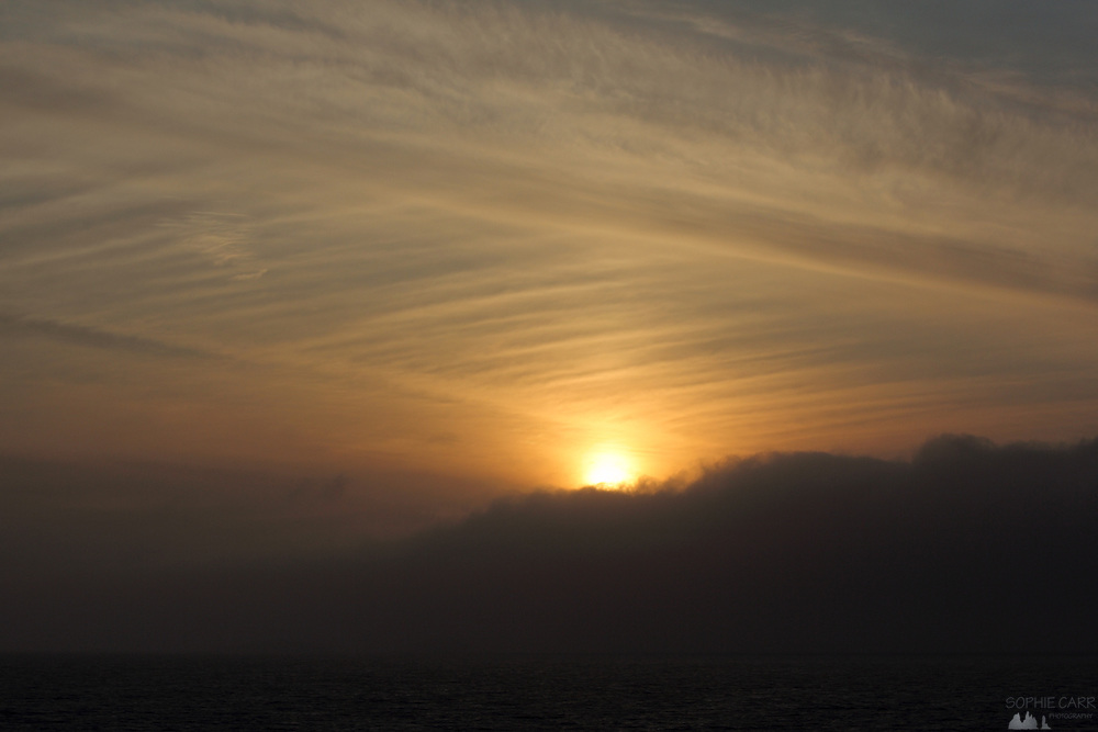 Sunset on The Inside Passage - falling behind the sea fog as we approach Prince Rupert