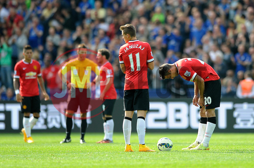 Manchester United's Adnan Januzaj and Manchester United's Robin van Persie cut dejected figures as they look to restart the game - Photo mandatory by-line: Dougie Allward/JMP - Mobile: 07966 386802 - 21/09/2014 - SPORT - FOOTBALL - Leicester - King Power Stadium - Leicester City v Manchester United - Barclays Premier League