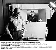 Duane Michaels left, preparing to photograph Richard Avedon at the Photograaphers for Friend's in Deed auction at Sotheby's. New York. February 5 1993. Film 93175f3<br />© Copyright Photograph by Dafydd Jones<br />66 Stockwell Park Rd. London SW9 0DA<br />Tel 0171 733 0108