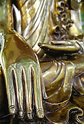 A golden statue of Buddha in Schwedagon pagoda, Yangon (Rangoon), Bruma (Myanmar)
