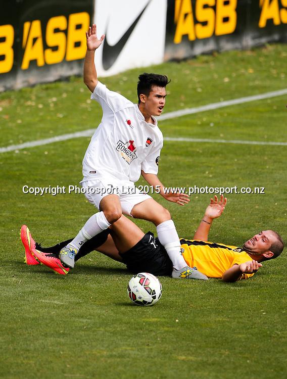 Canterbur's Miles John is tackled by Jarrod Smith. ASB Premiership Football - Wellington v Canterbury, 08 February 2015, , Wellington, New Zealand. Photo: John Cowpland / www.photosport.co.nz