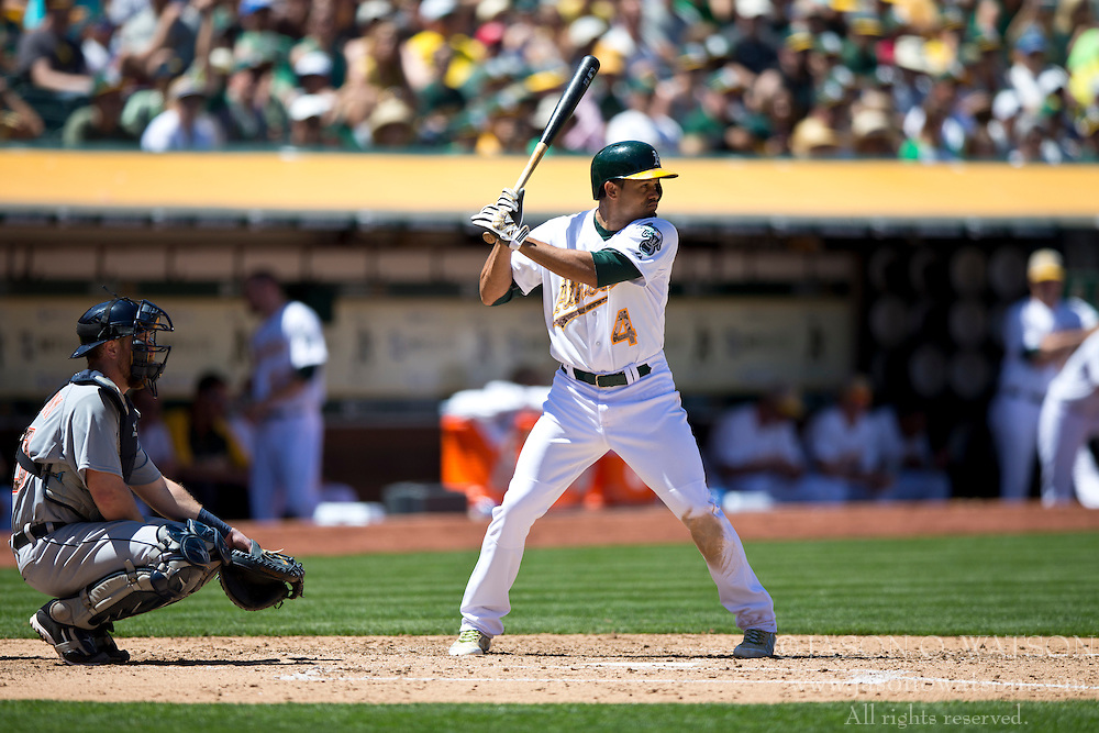 OAKLAND, CA - MAY 26:  Coco Crisp #4 of the Oakland Athletics at bat against the Detroit Tigers during the fourth inning at O.co Coliseum on May 26, 2014 in Oakland, California. The Oakland Athletics defeated the Detroit Tigers 10-0.  (Photo by Jason O. Watson/Getty Images) *** Local Caption *** Coco Crisp