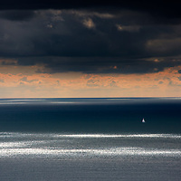 passage, voyage, trip, weekend, journey, alone, single, handed, huge, Tiny, yacht, on, ocean, light, beams, sea, on, clouds, white, distant, beams, storm, cloud, rain, round, the ,island, Race, Freshwater, English Channel, Isle of Wight, England, UK,