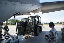 U.S. Air Force members from the 71st Rescue Squadron load gear and equipment in to an HC-130J Combat King II traveling to Texas in preparation of possible hurricane relief support August 26, 2017, at Moody Air Force Base, Ga. The 23d Wing launched HC-130J Combat King IIs, HH-60G Pavehawks, aircrew and other support personnel to preposition aircraft and airmen, if tasked to support Hurricane Harvey relief operations. (U.S. Air Force photo by Staff Sgt. Eric Summers Jr.)