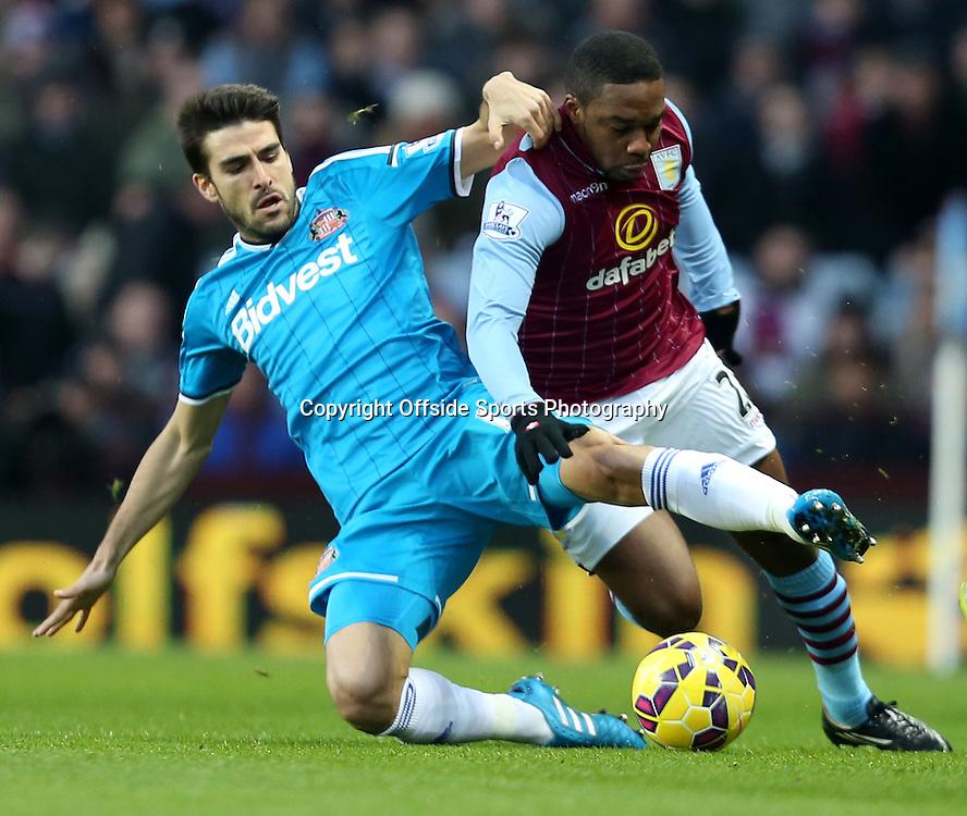 28th December 2014 - Barclays Premier League - Aston Villa v Sunderland - Jordi Gomez of Sunderland slides in to win the ball from Charles N'Zognia of Aston Villa - Photo: Paul Roberts / Offside.
