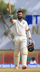 July 26, 2017 - Galle, Sri Lanka - Indian cricketer Cheteshwar Pujara raises his bat after scoring a century (100 runs) during the 1st Day's play in the 1st Test match between Sri Lanka and India at the Galle International cricket stadium, Galle, Sri Lanka on Wednesday 26 July 2017. (Credit Image: © Tharaka Basnayaka/NurPhoto via ZUMA Press)