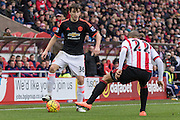 Manchester United's Defender Matteo Darmian on the ball watched by Sunderland's Midfielder Wahbi Khazri during the Barclays Premier League match between Sunderland and Manchester United at the Stadium Of Light, Sunderland, England on 13 February 2016. Photo by George Ledger.