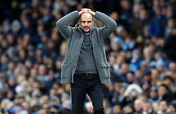 Manchester City manager Pep Guardiola reacts from the touchline during the Premier League match at the Etihad Stadium, Manchester.