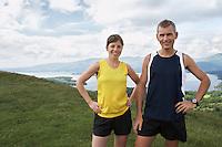 Couple standing on hillside portrait