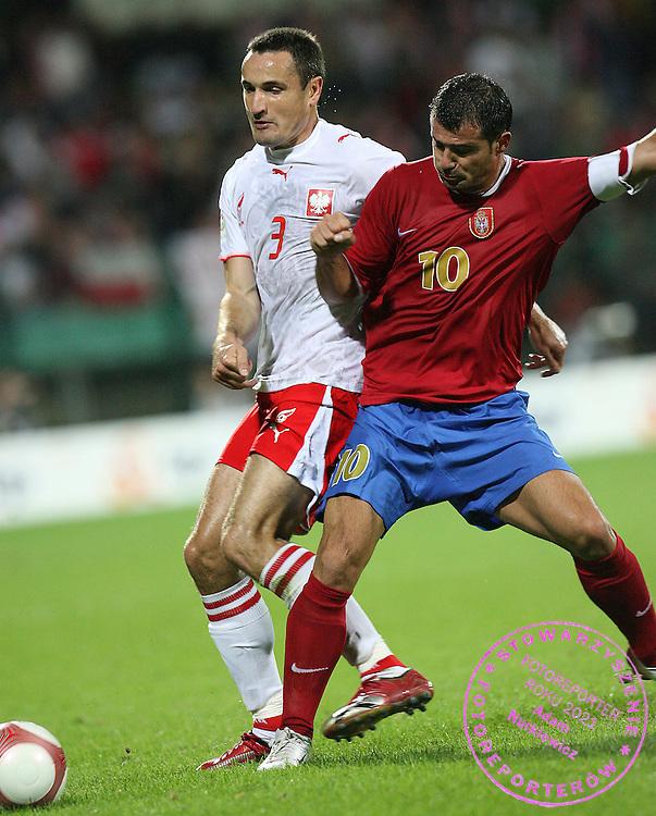 WARSZAWA  06/09/2006..POLAND _  ..Euro 2008 Group A qualifier ...ELIMINACJE MISTRZOSTW EUROPY..MARCIN WASILEWSKI /L./ I DEJAN STANKOVIC..FOT. PIOTR HAWALEJ / WROFOTO