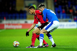 Cardiff City's Rudy Gestede holds the ball up from Peterborough United's Shaun Brisley whilst waiting for support - Photo mandatory by-line: Dougie Allward/JMP  - Tel: Mobile:07966 386802 15/12/2012 - SPORT - FOOTBALL -  Championship -  Cardiff-  New Cardiff City Stadium  -  Cardiff City v Peterborough United