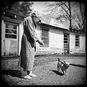Mrs. White and her dog in front their now closed general store, Dogtown, Mississippi