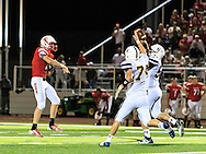 August 25, 2016: Norwalk Truckers Jordan Weinert (74) and Keegan Livingston (54)  knock down Port Clinton's pass attempt during the Thursday Night Season Opener game between the Norwalk Truckers vs Port Clinton Redskins at the Tru-Lay Stadium in Port Clinton, Ohio. FINAL: Norwalk 17 vs. Port Clinton 28