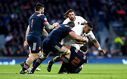 Nathan Hughes of England is tackled by Yoann Maestri and Guilhem Guirado of France - Mandatory by-line: Robbie Stephenson/JMP - 04/02/2017 - RUGBY - Twickenham - London, England - England v France - RBS Six Nations
