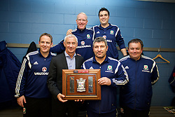 BALLYMENA, NORTHERN IRELAND - Thursday, November 20, 2014: Wales' Allan Bickerstaff, Carl Darlington, Ian Rush, Osian Roberts, xxxx and Gus Williams with the Victory Shield after a 2-0 win over Northern Ireland during the Under-16's Victory Shield International match at the Ballymena Showgrounds. (Pic by David Rawcliffe/Propaganda)