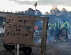 November 21, 2018 - Nantes, France - On November 21, 2018, for their 5th day of mobilization, thirty yellow vests are still mobilized Porte d'Armor, output of the Nantes ring road giving access to the Atlantis commercial area. Some spent the night where they improvised a camp.Yellow Vests distribute snacks to truckers showing their solidarity with the honking movement. (Credit Image: © Estelle Ruiz/NurPhoto via ZUMA Press)