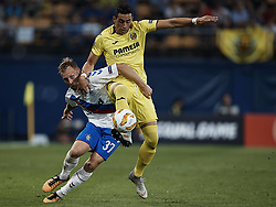 September 20, 2018 - Villarreal, Spain - Scott Arfield of Rangers (L) competes for the ball with Funes Mori of Villarreal CF during the UEFA Europa League group G match between Villarreal CF and Rangers at Estadio de la Ceramica on September 20, 2018 in Vila-real, Spain  (Credit Image: © David Aliaga/NurPhoto/ZUMA Press)