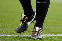 Match referee Neil Swarbrick has rainbow laces on his boots during the Premier League match at Old Trafford, Manchester.
