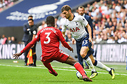 Tottenham Hotspur Defender Ben Davies (33) and Fulham Defender Ryan Sessegnon (3) battle for the ball during the Premier League match between Tottenham Hotspur and Fulham at Wembley Stadium, London, England on 18 August 2018.