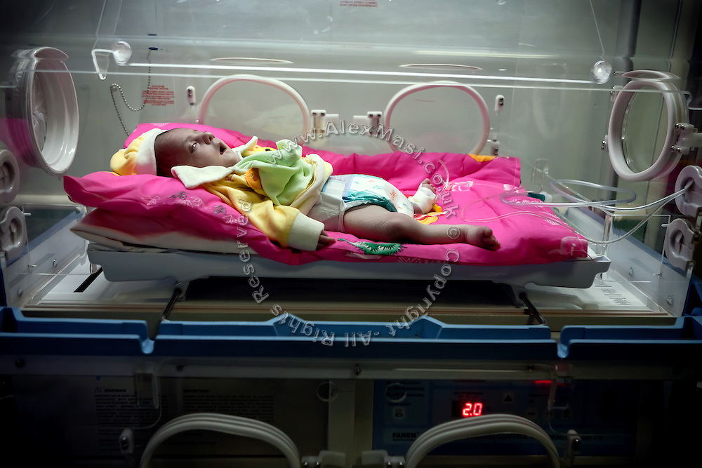 A newborn suffering from a severe neurological disorder and paralysis is lying in an incubator inside the children's ward at Fallujah General Hospital, Iraq. More then 15 per cent of children at the hospital are now being born with some sort of congenital defect. The average elsewhere in the world is believed to be between 2 and 4 per cent.