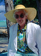 British woman wearing large hat for shade, Grand Cayman, Cayman Islands,