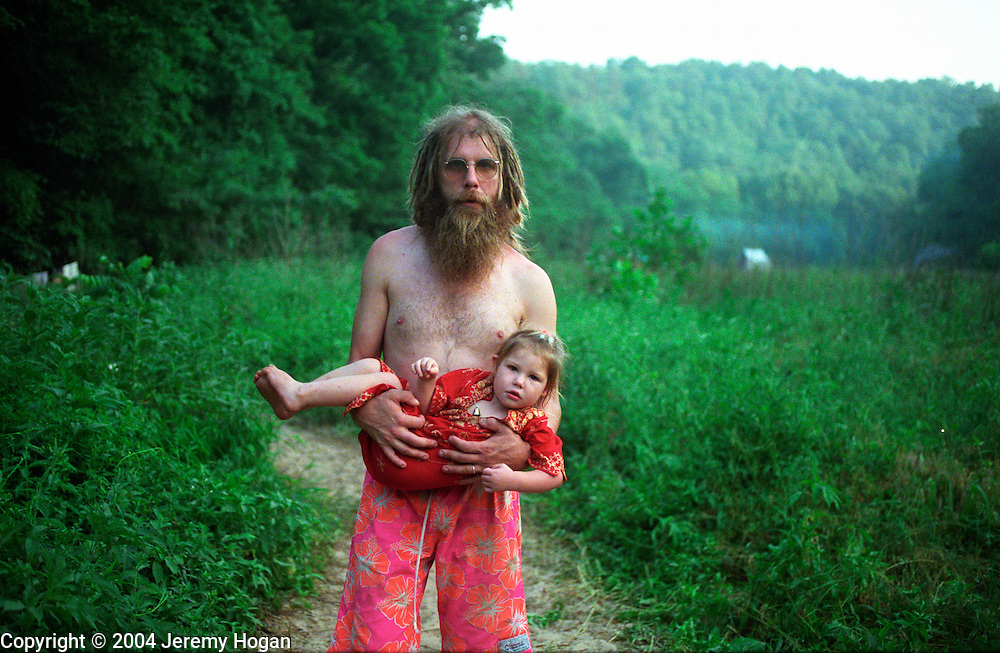 Man and child at a Rainbow Gathering, Missouri. 1996  rainbow gathering,