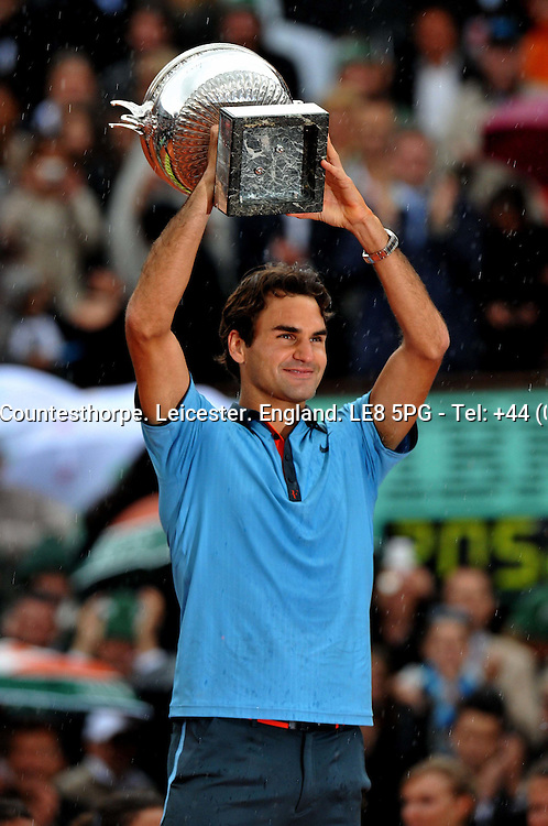 Roger FEDERER (SUI) the men's No 2 seed celebrating with the winner's trophy after beating Robin SODERLING (SWE) the men's No 23 in the French Open 2009 Men's Final<br /> <br /> Roger FEDERER (SUI) Robin SODERLING (SWE) 6-1 7-6 (7-1) 6-4<br /> <br /> Tennis - French Open - Day 15 - Sun 07 Jun 2009 - Roland Garros - Paris - France<br /> <br /> &copy; CameraSport - 43 Linden Ave. Countesthorpe. Leicester. England. LE8 5PG - Tel: +44 (0) 116 277 4147 - admin@camerasport.com - www.camerasport.com