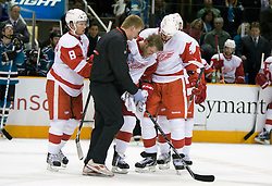April 29, 2010; San Jose, CA, USA; Detroit Red Wings right wing Dan Cleary (center) is helped off the ice during the second period in game one of the western conference semifinals of the 2010 Stanley Cup Playoffs against the San Jose Sharks at HP Pavilion.  San Jose defeated Detroit 4-3. Mandatory Credit: Jason O. Watson / US PRESSWIRE