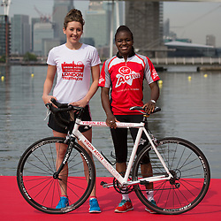 © Licensed to London News Pictures. 27/07/2013. London, UK. Jade Jones and Nicola Adams pose with a bicycle at the London Triathlon 2013 at the ExCel centre in Royal Victoria Dock in East London. Photo credit : Vickie Flores/LNP