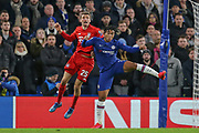 Bayern Munich forward Thomas Müller (25) battles for possession in the air with Chelsea defender Reece James (24) during the Champions League match between Chelsea and Bayern Munich at Stamford Bridge, London, England on 25 February 2020.