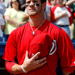March 4, 2011; Viera, FL, USA; Washington Nationals right fielder Bryce Harper (34) stands for the national anthem before a spring training exhibition game against the Atlanta Braves at Space Coast Stadium.  Mandatory Credit: Derick E. Hingle