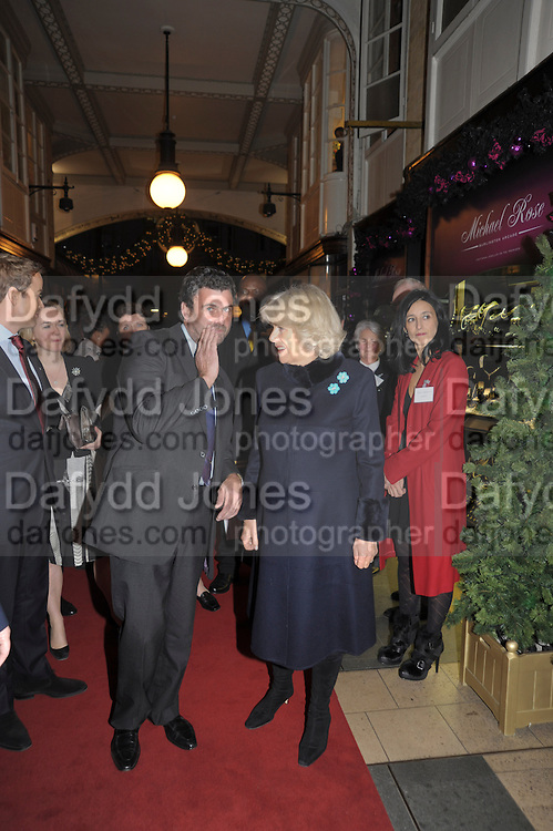TREVOR PICKETT;  THE DUCHESS OF CORNWALL MEETING GUESTS AND SHOPKEEPERS, The Duchess of Cornwall switches on the Christmas lights at the Burlington Arcade in Piccadilly, London, November 23,  London. 23 November 2011.