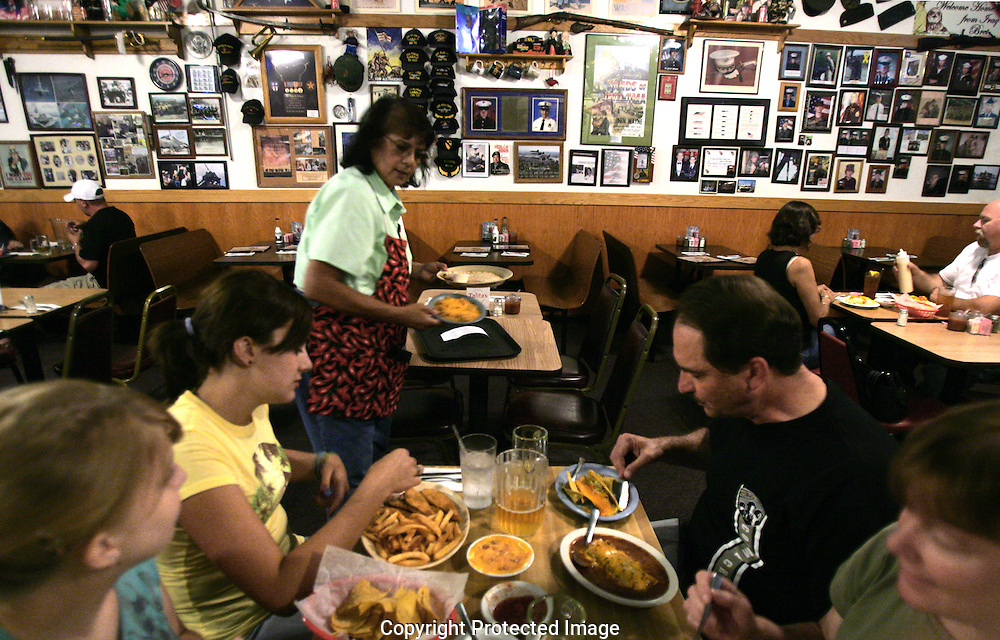 Server Toni West, sister of owner Frankie Prince, takes care of customers at Talita's Mexican Kitchen, 3090 Southwest Blvd., Grove City, Ohio.(Jodi Miller/Alive)