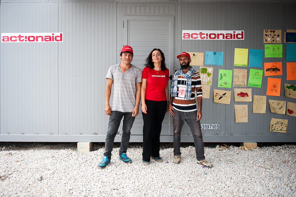 Abbas ActionAid's Afghan translator in Lesvos , Hara Tasoglou, head of communications of ActionAid Hellas, Hamid ActionAid's Afghan translator in Lesvos outside ActionAid's office container in Kara Tepe camp, Lesvos, Greece