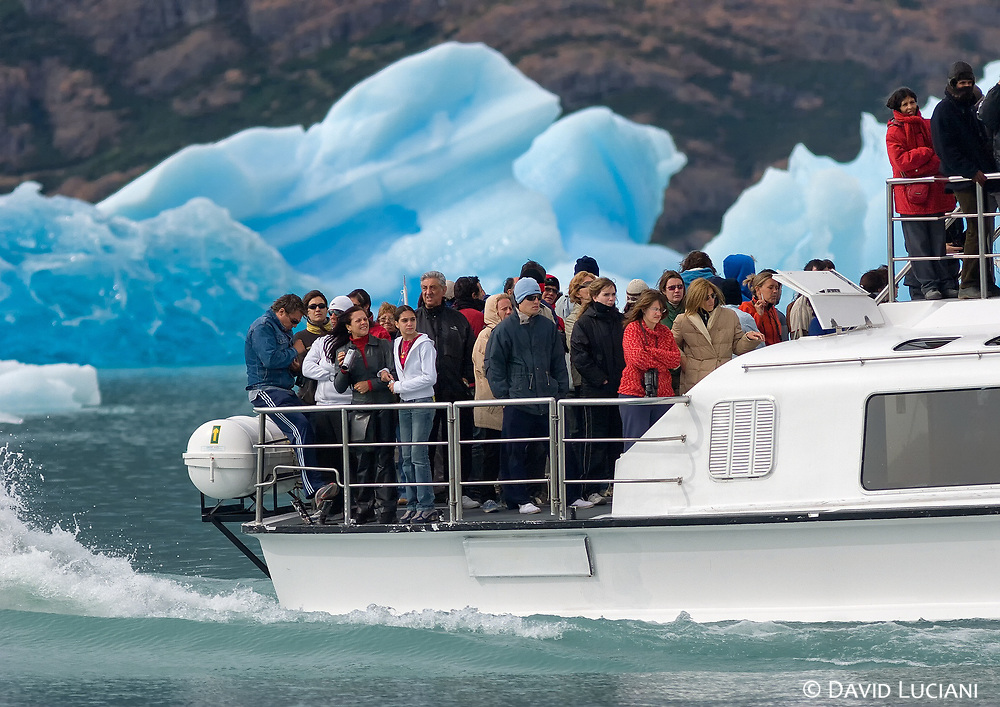 The one day boat excursion in Los Glaciares National Park is one of the touristic highlights in the patagonian region. <br /> I took the photo of this boat - where tourists were crammed like sardines, while we were drinking a glas of whisky, cooled by some 5000-year-old ice cubes from a floating glacier fragment in our large and comfortable boat :-)