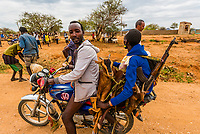 Men on motorcycle taking goats that they bought at the Hamer tribe weekly market in Turmi, Omo Valley, Ethiopia.