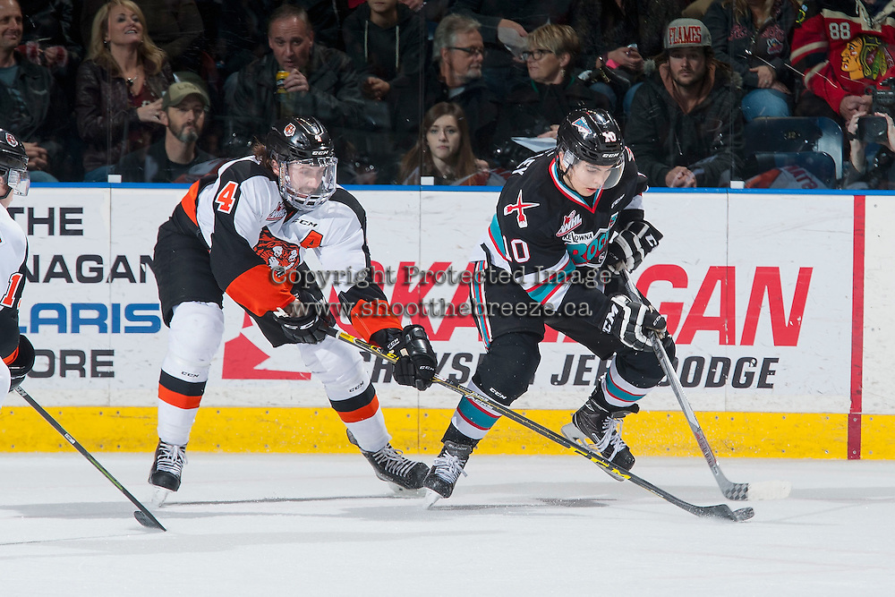 KELOWNA, CANADA - DECEMBER 4: Ty Stanton #4 of Medicine Hat Tigers stick checks Nick Merkley #10 of Kelowna Rockets on December 4, 2015 at Prospera Place in Kelowna, British Columbia, Canada.  (Photo by Marissa Baecker/Shoot the Breeze)  *** Local Caption *** Ty Stanton; Nick Merkley;