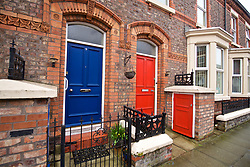 LIVERPOOL, ENGLAND - Sunday, March 3, 2019: A blue an red front door of neighbours in a local street to the two stadiums of Everton and Liverpool pictured before the FA Premier League match between Everton FC and Liverpool FC, the 233rd Merseyside Derby, at Goodison Park. (Pic by Paul Greenwood/Propaganda)
