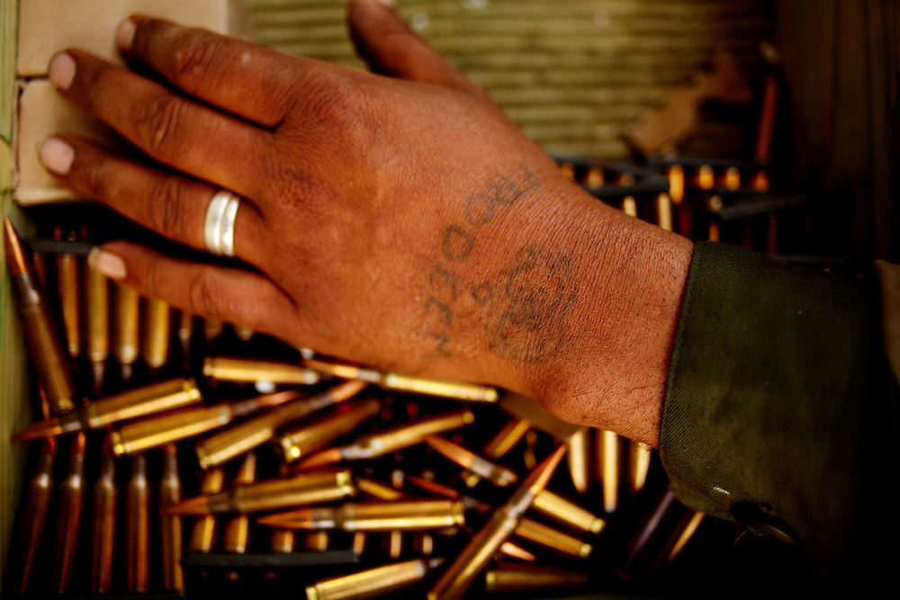 Benghazi, Libya, 01.03.11..Frodeem is freedom mispelled. The hand of a fighter preparing munitions for the fighters...Photo by: Eivind H. Natvig/MOMENT