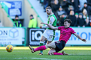 Kieran Tierney (#63) of Celtic slides in to block the shot from Martin Boyle (#17) of Hibernian during the Ladbrokes Scottish Premiership match between Hibernian and Celtic at Easter Road, Edinburgh, Scotland on 10 December 2017. Photo by Craig Doyle.