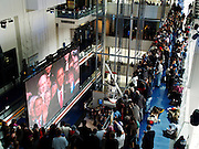 Visitors to the Newseum in Washington, D.C. watch as President-Elect Barack Obama takes the oath to become the 44th President of the United States of America on Tuesday, January 20, 2009.