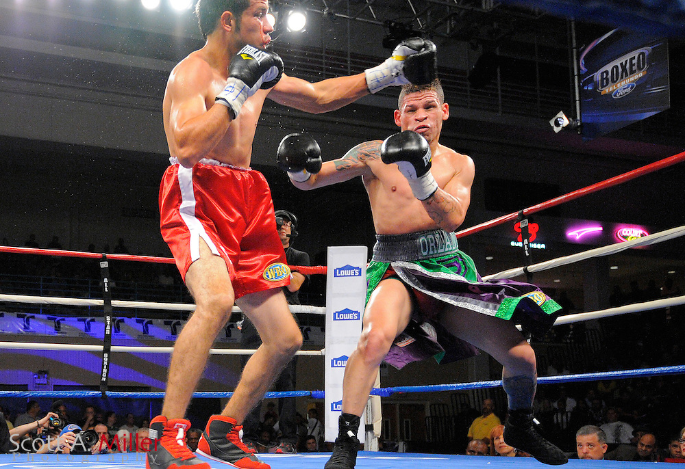 Orlando Cruz, right, and  Jorge Pazos during their WBO NABO featherweight title fight against at the Kissimmee Civic Center in Kissimmee, Florida October 19, 2012. Cruz won by decision. ©2012 Scott A. Miller.