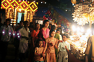 A Hindu festival in Tripanthura, India. Partipants lit candles lining the walls of the temple, and elephants were walked into the temple.
