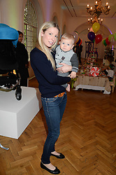 AMANDA SELLMAN and her son ELLIS SELLMAN at a children's tea party to celebrate the 80th anniversary of iCandy - the luxury British pushchair brand held at One Marylebone, Marylebone Road, London NW1 on 10th September 2013.